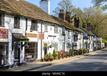 Prestbury is a historic village in Cheshire East.  This is the main street with shops and restaurants - Stock Image