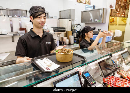 London England United Kingdom Great Britain Lambeth South Bank Waterloo Station Oseyo Korean Food & Culture Hub restaurant take-away fast food Asian boy girl teen server counter - Stock Image