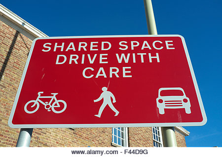 Road sign for a shared user road space area in central Gloucester, UK. - Stock Image