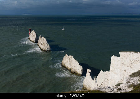 A yacht passing by The Needles, Isle of Wight - Stock Image