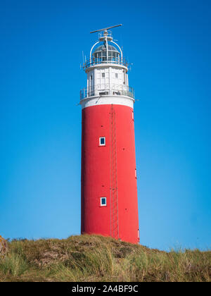 View of the Eierland Lighthouse next to the dunes of Texel in The Netherlands. - Stock Image