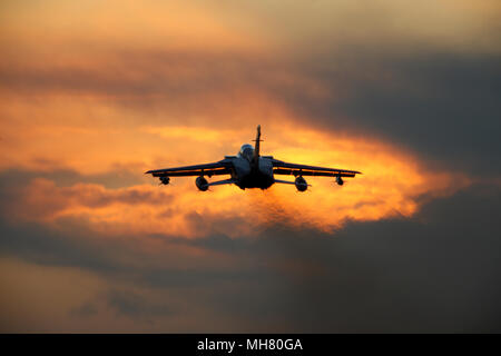 Royal Air Force Panavia Tornado GR4 combat aircraft at sunset. wheels down ready to land. The Tornado fleet are due to be retired in early 2019 - Stock Image