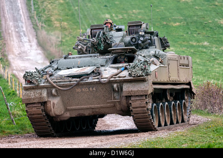 A British Army Warrior Infantry Fighting Vehicle on the Salisbury Plain Military Training Area in Wiltshire, United - Stock Image