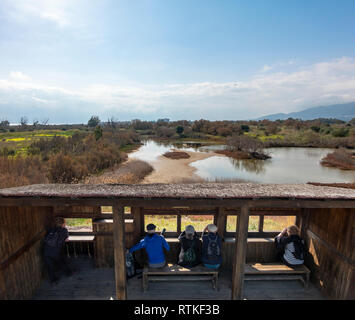 Birdwatching British tourists expats bird watching from a hide Guadalhorce River Estuary Natural Area in Malaga, Costa del Sol, Spain in February. - Stock Image