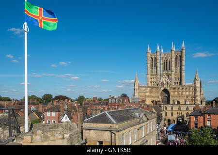 Historic City of Lincoln, UK, with Lincoln Cathedral in the background, and  Lincolnshire county flag in the foreground. - Stock Image