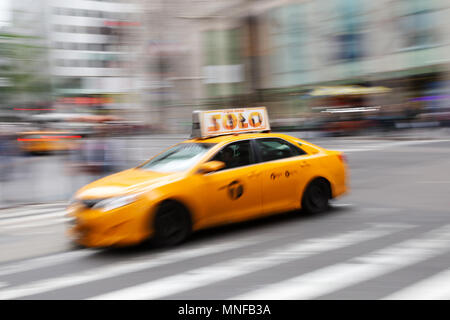 New York taxi, motion blur, fifth avenue, New York city, USA - Stock Image