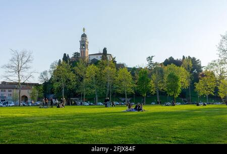 Udine, Italy (23rd April 2021) - View of the hill with the castle and the church of Saint Mary from Piazza I maggio square - Stock Image