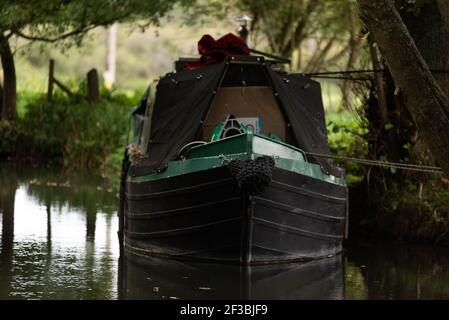 Canal boats on river Kennet overcast day holiday break - Stock Image