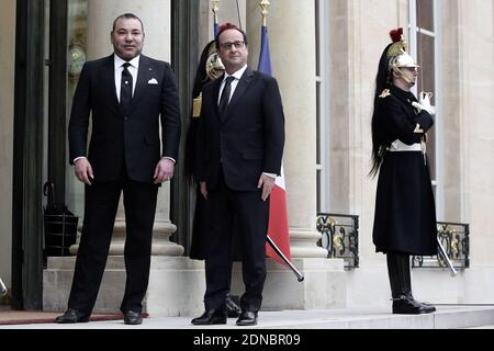 French President Francois Hollande welcomes Morocco's King Mohammed VI prior to a meeting at Elysee Presidential Palace, in Paris, France, on February 09, 2015. Photo by Stephane Lemouton/ABACAPRESS.COM - Stock Image