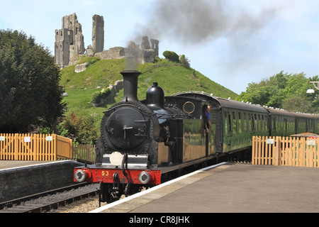 The Train arriving at Corfe Castle Station - Stock Image