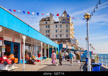 Llandudno, Conwy Wales, UK. 15th Aug, 2016. Summer finally arrives on the North Wales coast, and everyone gets out to enjoy the sunshine. Here people are out walking on the pier. Credit:  travellinglight/Alamy Live News - Stock Image