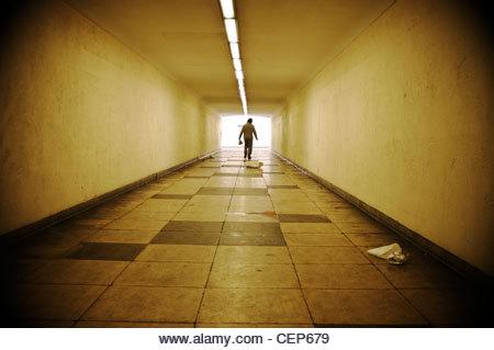 Man walking through an underpass, Birmingham, UK. - Stock Image