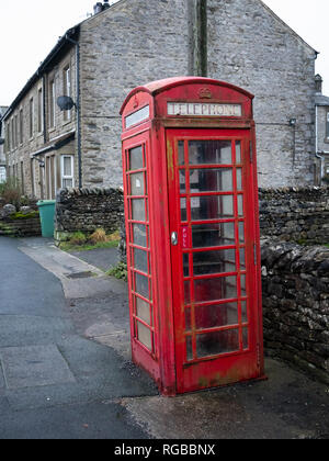An old red telephone box in the village of Horton in Ribblesdale in the Yorkshire Dales. - Stock Image