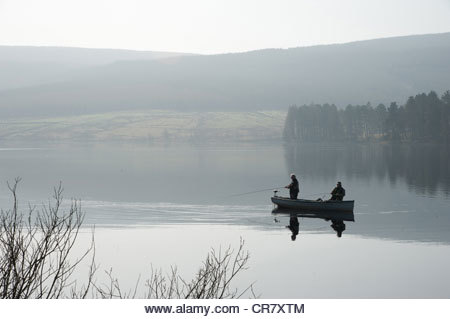Fishing on Keilder Water in Northumberland - Stock Image