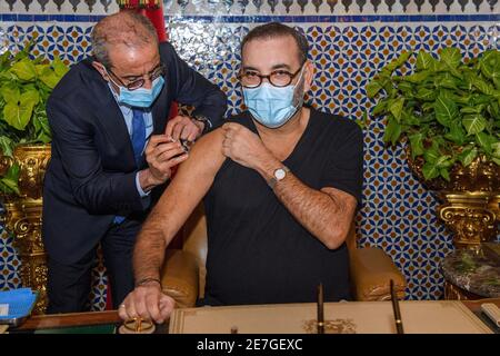 King of Morocco Mohammed VI receives the anti-COVID-19 vaccine and launches the vaccination campaign, on January 28, 2021 at the Royal Palace in Fez, Morocco. Photo by Aziz Boukallouche via DNphotography / ABACAPRESS.COM - Stock Image