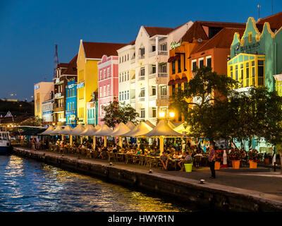 Curacao, Willemstad, Punda, colorful houses at waterfront promenade in the evening - Stock Image