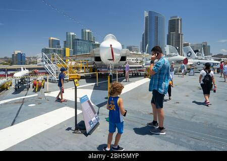 Historic aircraft carrier battleship and now a museum, the USS Midway is docked at downtown San Diego California and is a popular tourist attraction. - Stock Image