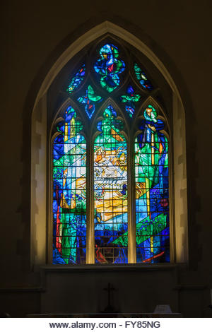 Stained Glass window by Patrick Reyntiens in All Saints Church, Odiham illustrating part of the Book of Revelations. - Stock Image