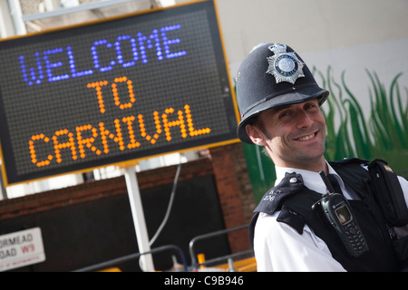 Notting Hill Carnival, Children's Day, friendly policeman - Stock Image