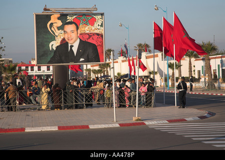 Crowds on the street with flags and large poster picture King Mohammed Essaouira, Morocco, north Africa - Stock Image