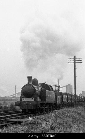 Lambton tank loco No. 29 passing Philadelphia with an NCB coal train in the 1960s, Co. Durham, England, UK - Stock Image