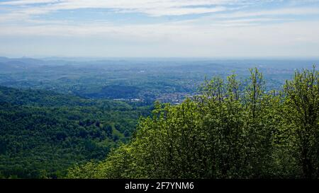 Green mountain of Sacro Monte in a sunny day with blue sky. - Stock Image