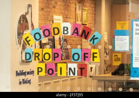Foodbank drop off point in the Woking branch of Nationwide Building Society in Surrey, UK, during the coronavirus Covid-19 pandemic, 2021 - Stock Image