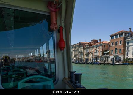 Venice, Italy (20th June 2020) - A 'vaporetto', venetian public transport, leading passengers through the Grand Canal - Stock Image