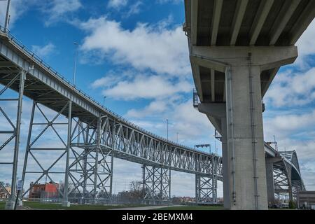 Blue Water Bridge connecting Port Huron, Michigan USA with Sarnia / Point Edward Ontario Canada - Stock Image