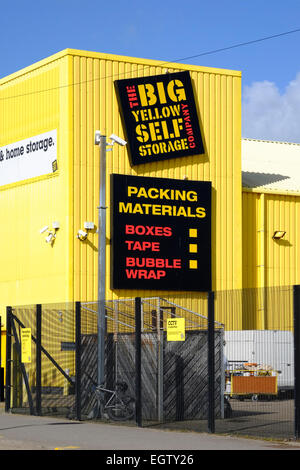 exterior of a big yellow self storage unit - Stock Image