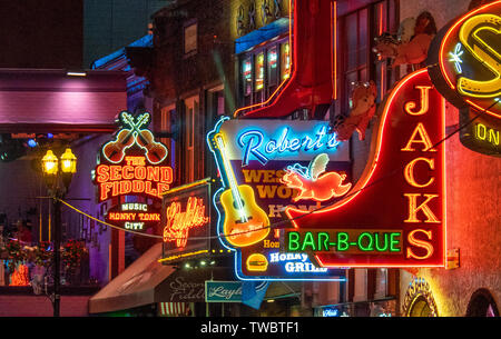 Restaurants bars and concert venues  neon signs lit up at night in Broadway Nashville Tennessee USA. - Stock Image