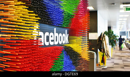 Dublin, Ireland. 09th Oct, 2013. Numerous colorful markers are stuck around the facebook logo in Facebook's European headquarters in Dublin, Ireland, 09 October 2013. Around 500 people work at the European Facebook headquarters in the Irish capital, taking care of the advertising business and dealing with users' complaints from Europe, the Middle East and Africa. Photo: Jessica Binsch/dpa/Alamy Live News - Stock Image