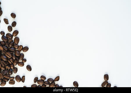 Pile of coffee beans close-up isolated on white background, with copy space - Stock Image