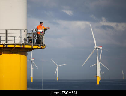 A worker signalling to a vessel on the Gwynt y Mor Wind Farm off the coast of North Wales during the Construction - Stock Image