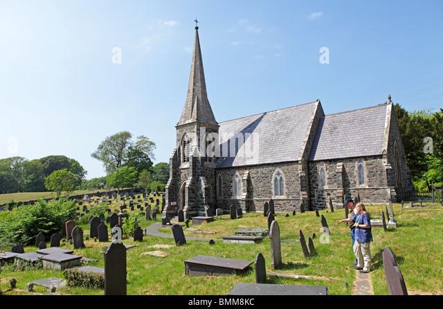 church and graveyard near Llanfairpwllgwyngyll... near Bangor, Anglesey Island, Wales, United Kingdom - Stock Image