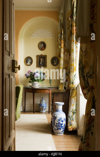 View through open door into living room with arched alcove in a 17th century Irish castle - Stock Image