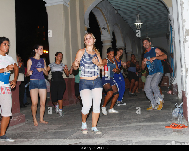 Cuban teenagers, youth, dancing on the street night time. Cienfuegos, Cuba, November 2010 - Stock Image