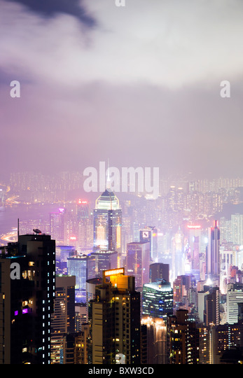 The amazing Hong Kong skyline as seen from The Peak lookout at night. The imposing structures include the central - Stock Image