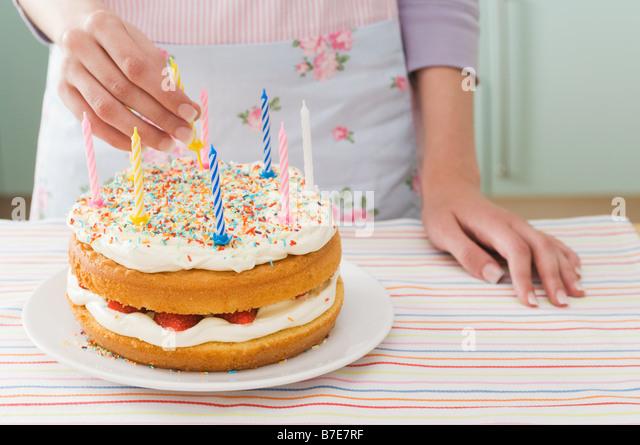 Woman with birthday cake - Stock Image