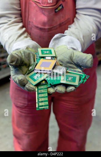 Berlin, Germany, the employee holds BRAL CPUs in the hands - Stock Image