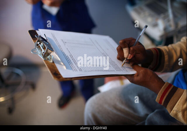 Cleveland, Ohio, USA. 30th Sep, 2013. A patient at preterm signs one of the forms required by Ohio law that ask - Stock Image