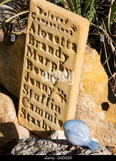 Backyard Memorial Gravestone for a Family's Pets, USA - Stock Image