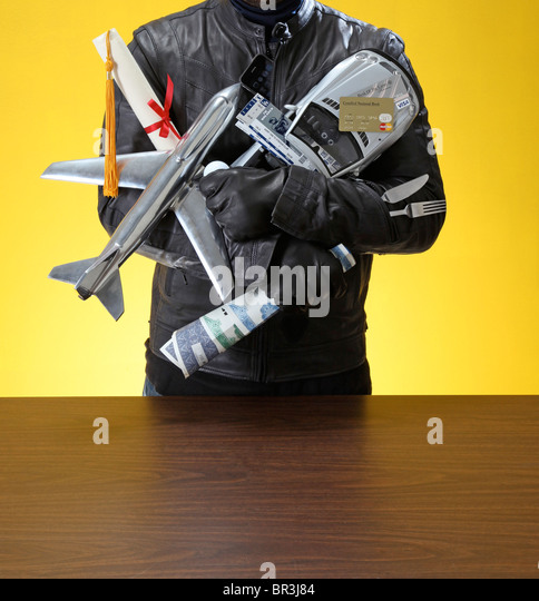guy or thief holding all the things that he likes - Stock Image