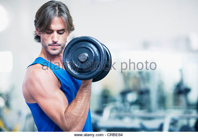 Man holding dumbbell - Stock Image