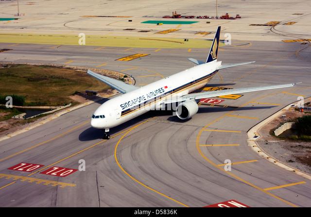 Singapore Airlines Boeing 777-312/ER at Barcelona, El Prat Airport, Spain - Stock Image