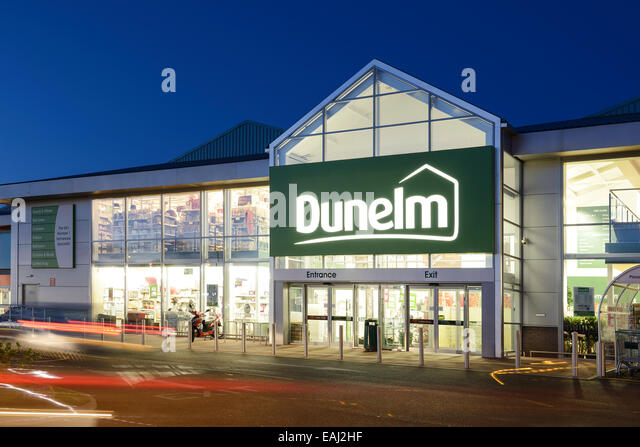 Dunelm store entrance at night - Stock Image