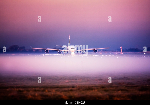 Airplane in the fog at London Heathrow Airport, UK - Stock Image