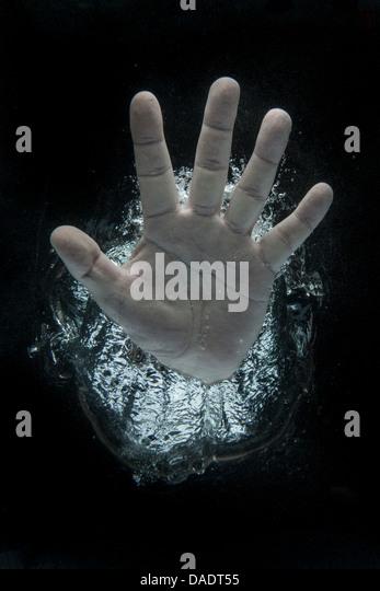 Open hand beneath water - Stock Image