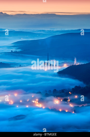 The Lafarge Cement Works & Lights of Castleton in Fog, Hope Valley, Peak District National Park, Derbyshire, - Stock Image