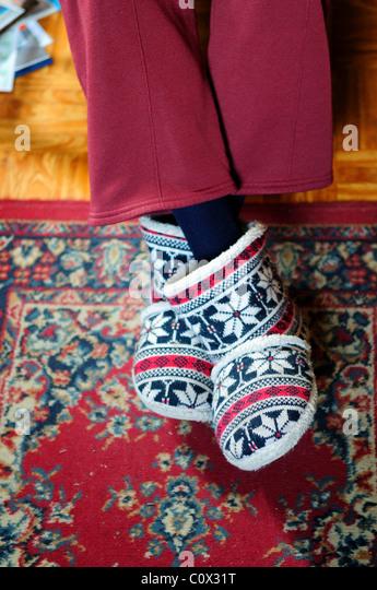 Elderly Lady Wearing Slippers. - Stock Image